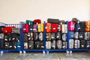 piles of luggages in airport