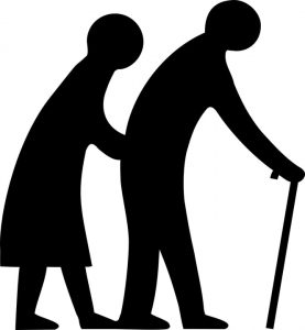 two senior people walking with a cane