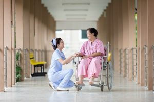 nurse with patient in a wheelchair